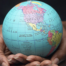Globe of the world in one's hands