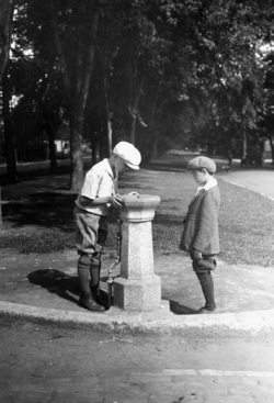 Two boys at a drinking fountain