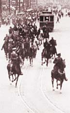 The Mounted Police charging down Main Street